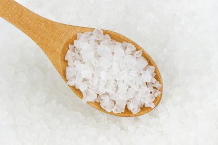 Salt crystals in wooden scoop.